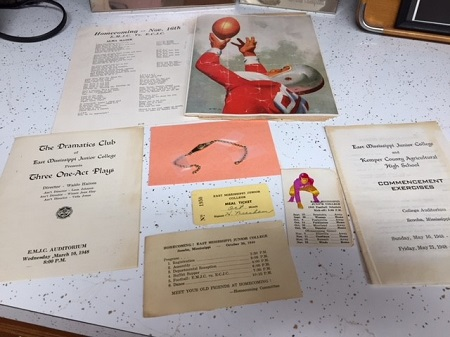 Items donated to EMCC's archives include various school documents from their years at the college, such as a meal ticket, football schedule, and pamphlets of a commencement exercise and a play presented by The Dramatics Club.