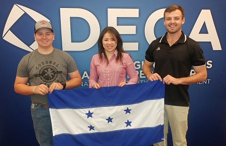 EMCC students, from left, Cody Troyer, Gissela Perdomo and Clayton Forrester at a Fall Leadership Conference in New York City. The students are holding the national flag of Honduras, which is Perdomo's home country.
