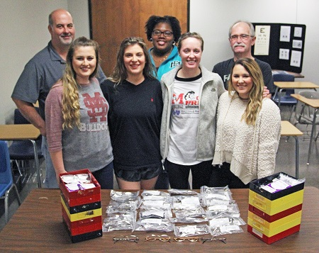 Students in EMCC's Ophthalmic Technology program have already completed dozens of pairs of eyeglasses which will be donated during an upcoming mission trip to Haiti by Shared Vision International of Lincoln, Neb.