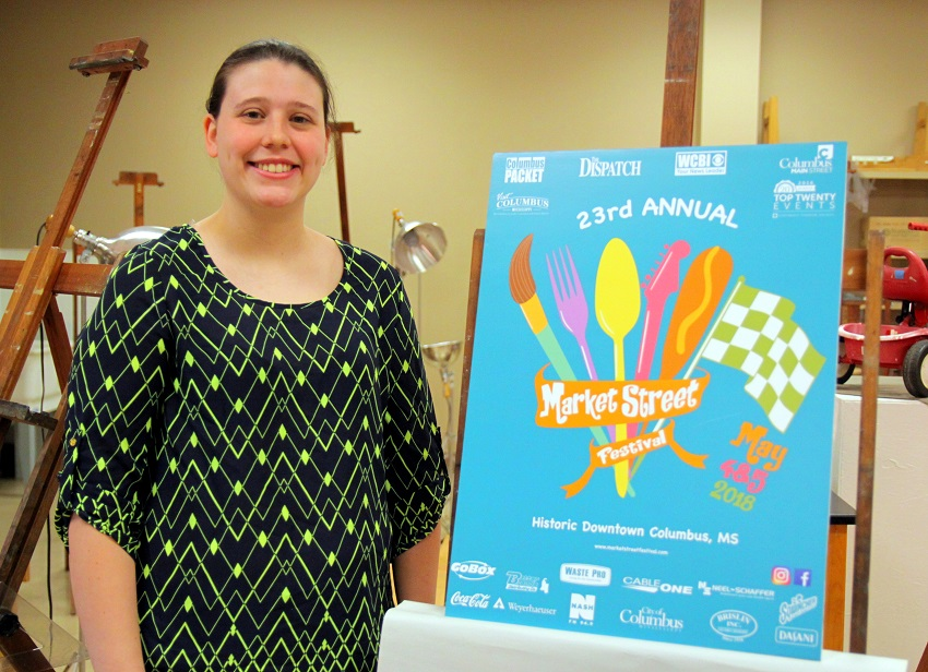 Former East Mississippi Community College student Kelly Brown with the winning design she came up with that is being used to promote the upcoming 23rd Annual Market Street Festival in Columbus.