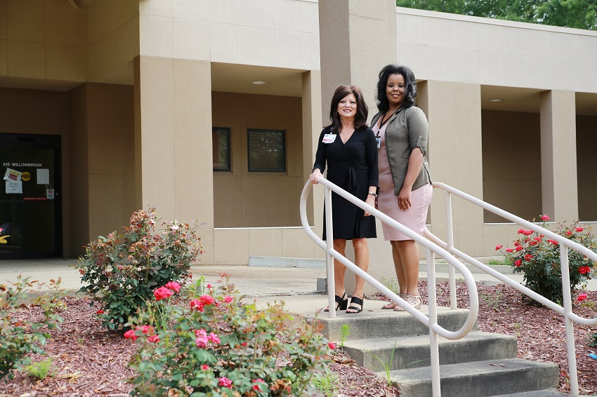 Baptist Memorial Hospital- Golden Triangle Chief Nursing Officer Mary Ellen Sumrall, at left, and East Mississippi Community College Surgical Technology Program Director Janan Rush outside a building owned by Baptist that will house the college's new program to train surgical technologists.