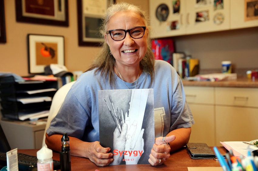 "East Mississippi Community College Humanities instructor Marilyn Ford with the 2016-17 issue of ""Syzygy,"" which won first place in the 2018 Mississippi Community College Creative Writing Association's annual workshop and contest."