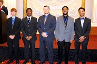 Four students in East Mississippi Community College's Business and Marketing Management Technology program earned awards in the Entrepreneurship category in a competition held during the DECA ENGAGE Conference in New York City. At center is EMCC District Director of Marketing Communications and Recruitment Dr. Joshua Carroll. The EMCC students are, from left, William Manuel, Brandon Carter, Marcus Black and Nathaniel Craft.