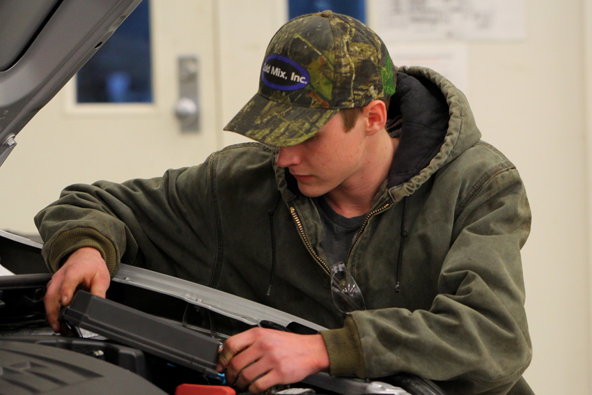 East Mississippi Community College student Cameron Bryce Hitt is one of five Automotive Technology students chosen to participate in a new pilot program that will allow students to earn certification through the University of Toyota. Here, Hitt inspects a 2015 Toyota Camry during a class exercise.
