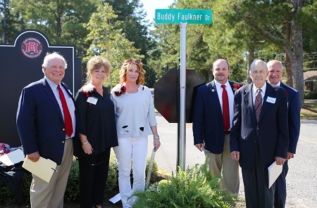 During East Mississippi Community College's Homecoming activities, a road on the college's Scooba campus was renamed and dedicated in memory of the late Buddy Faulkner, a long-time supporter of the college. Pictured at the dedication are, from left, former EMCC Vice President of Institutional Advancement Nick Clark, EMCC Director of Alumni Affairs and Foundation Operations Gina Cotton, Tina Faulkner, the wife of Buddy Faulkner, EMCC Executive Director of College Advancement Marcus Wood, EMCC Development Foundation Board member Ike Hopper, and EMCC Interim President Dr. Randall Bradberry.