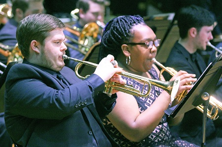Members of East Mississippi Community College's Mighty Lion Band will perform during the college's Fine Arts Holiday Celebration Nov. 27. Here, current band member William Hodge and former band member Deja Allen perform during an event last year.