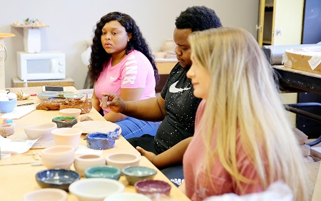 East Mississippi Community College students in art instructor Terry Cherry's class work on pottery that will be for sale during the college's Fine Arts Holiday Celebration Nov. 27. The students are, from left, Ciara Darden, Brandon Holmes and Jenna Brooke Hailey.