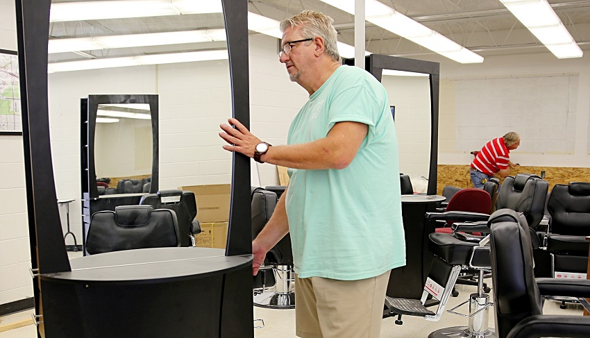 David Long sets up equipment for East Mississippi Community College's new Barbering program. Long will oversee both the Cosmetology and Barbering programs at EMCC. Classes begin in August and a few spots in the Barbering program are still available.