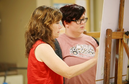 East Mississippi Community College art instructor Cindy Buob, at left, gives Mathiston resident Sabrina Shields some pointers during a drawing class. Buob's artwork will be featured in an upcoming exhibit in Meridian.