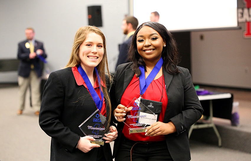 East Mississippi Community College students Laney Horne of Gulfport, at left and Destiny Jefferson-White of West Point and took first place in the International Marketing category during the Mississippi Collegiate DECA's 2019 Career Development Conference. EMCC students won awards in 14 categories during the competition.