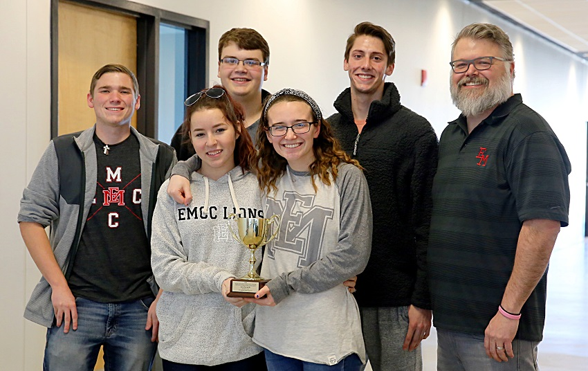 East Mississippi Community College's quiz bowl team took first place in the 2019 Community College Sectional Championship Quiz Bowl Tournaments Jan. 25 and qualified to compete nationally. Pictured in the front row with the team's trophy are, from left, Hayley McCann and Belle Ferrebee. In the back row are, from left, Justin Labonte, Cameron Wilcox, Jaden Bennett, and EMCC Quiz Bowl Coach Scott Baine.