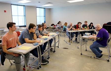 East Mississippi Community College's quiz bowl team, seated at left, competes against Bevill State Community College's team during the National Academic Quiz Tournaments' Mississippi Community College Sectional.