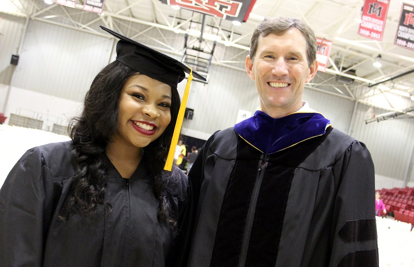 Kelsey Hearn, at left, is congratulated by East Mississippi Community College President Dr. Scott Alsobrooks during the college's May 4 commencement ceremony on the Scooba campus. Hearn, who was among the graduates, will graduate from Kemper County High School May 24.