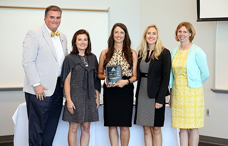 East Mississippi Community College mathematics instructor Alison Alexander, at center, was among the graduates of the Golden Triangle Leadership Program. A graduation ceremony was held June 5 at the college's Communiversity.