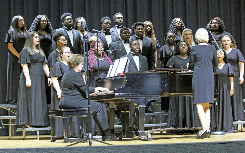 East Mississippi Community College's annual Pine Grove Arts Festival returns April 9-12, with activities planned on the Scooba and Golden Triangle campuses. Here, Scooba Choir Director Dr. Lorrie Stringer leads a choir performance during last year's festival.