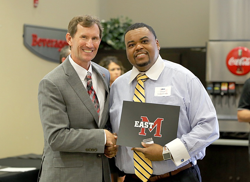 EMCC Math and Science Scooba Campus Division Chair Jairus Johnson is presented a service award certificate for his 15 years of employment with the college by EMCC President Dr. Scott Alsobrooks. Johnson was among 32 EMCC employees presented service awards Aug. 12 during the college's annual convocation.