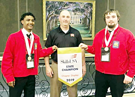 East Mississippi Community College students Isiah Woods of Louisville, at left, and Dylan Copeland of Nanih Waiya took first place in the Chapter Display Team Welding category during the Mississippi SkillsUSA Championships in Jackson. Both students, who are pictured with welding instructor Shane McDaniel, are enrolled at the college's Scooba campus.
