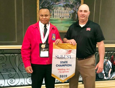 East Mississippi Community College student Bryson Jenkins of DeKalb, at left, took first place in Welding Sculpture in the Mississippi SkillsUSA Championships in Jackson. He is enrolled in the Welding Technology Program at the college's Scooba campus, which is taught by welding instructor Shane McDaniel, at right.