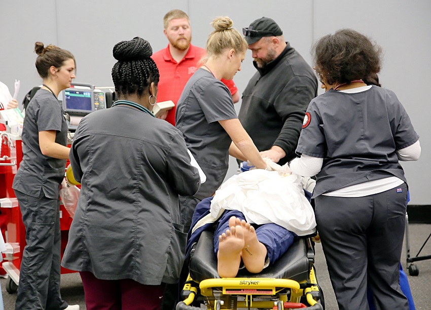 Students enrolled in East Mississippi Community College's Division of Nursing and Allied Health participate in a March medical emergency simulation prior to the outbreak of the coronavirus. A drive-by graduation for students in the Paramedic, Practical Nursing and Surgical Technology programs will take place July 25.