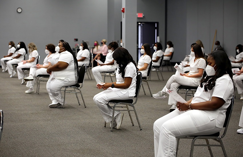 Forty-three graduates of East Mississippi Community College's Associate Degree Nursing and Surgical Technology programs participated in a pinning ceremony the morning of Tuesday, Nov. 24, in the Lyceum Auditorium on the college's Golden Triangle campus.