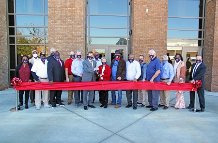 East Mississippi Community College administrators and members of the Board of Trustees were joined by area legislators, county supervisors and officials from K-12 schools for a Dec. 10 ribbon cutting for a new student residence hall on the college's Scooba campus.