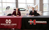 Mississippi State University President Dr. Mark E. Keenum, at left, and East Mississippi Community College President Dr. Scott Alsobrooks sign a memorandum of understanding that will allow graduates of EMCC's career technical programs to transfer their credits to MSU's new Bachelor of Applied Science program.
