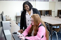 East Mississippi Community College Adult Education Launch Pad East lead instructor Tshurah Dismuke, at left, helps Columbus resident Destiny Monroe with an assignment. The facility that offers free services opened in Columbus last October.
