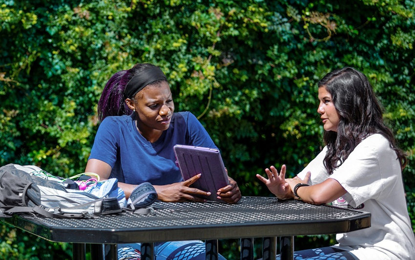 Students on East Mississippi Community College's Scooba campus chat between classes in this file photo. EMCC will be offering online courses during the Maymester term.