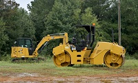 APAC Mississippi, Inc., donated a Caterpillar asphalt roller, at right, to our Workforce and Community Services division that will be used for training students enrolled in the Heavy Civil Construction program. Pictured at left is an excavator also used in the program that teaches students about the safe operation of heavy equipment.