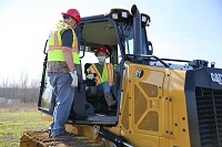 East Mississippi Community College Heavy Civil Construction instructor Carlton Ray Hollis, Sr., at left, gives student Tammy Warren pointers on the operation of a dozer used in the program. Appalachian Regional Commission grant funds will be used to purchase additional equipment for the program.