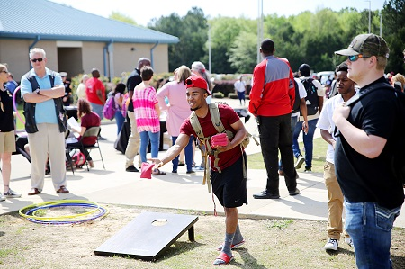 East Mississippi Community College's Pine Grove Arts Festival returns April 13-21. Here, a student takes part in one of the games at a previous festival on the Golden Triangle campus.