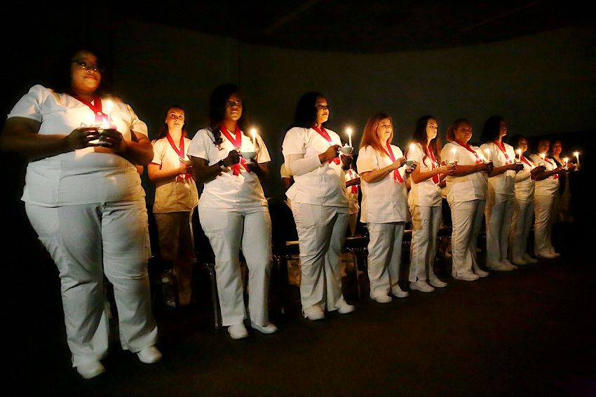 Eighteen students graduated from East Mississippi Community College's Practical Nursing program in a pinning ceremony July 30 in the Lyceum Auditorium on the college's Golden Triangle campus.