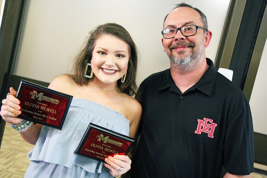 Olivia Newell, at left, was named the recipient of both the Outstanding Human Anatomy & Physiology II Student and the Outstanding American Literature Student during Awards Day on East Mississippi Community College's Scooba campus. Newell is pictured here with humanities instructor Derrick Conner, who presented her with the American Literature award.
