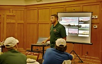 East Mississippi Community College Landscape Management Technology student John Ellis gives a presentation on his summer internship at a Florida golf course to his classmates, who all landed paid internships.